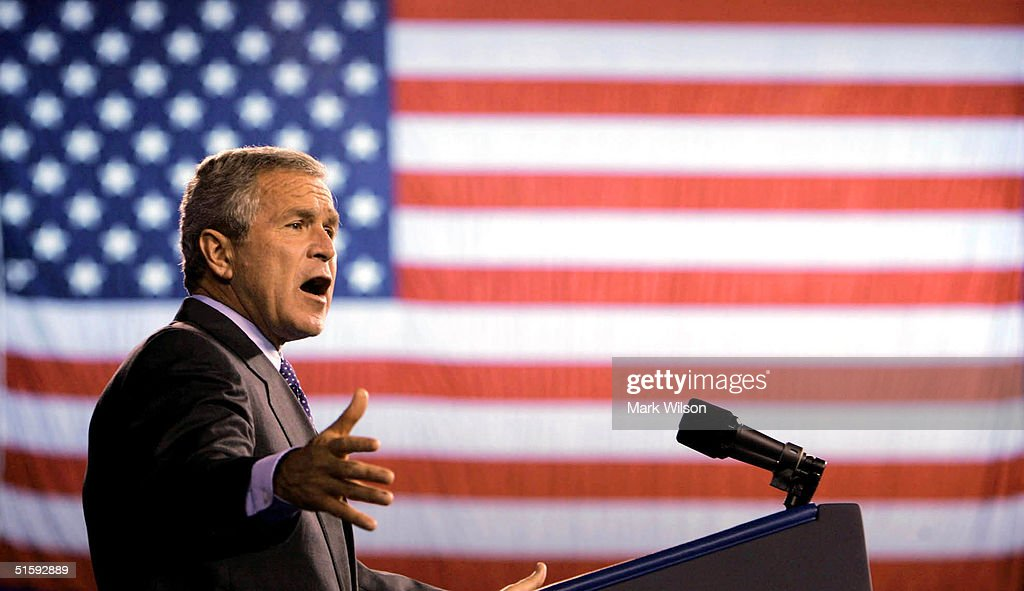 U.S. President <a gi-track='captionPersonalityLinkClicked' href=/galleries/search?phrase=George+W.+Bush&family=editorial&specificpeople=122011 ng-click='$event.stopPropagation()'>George W. Bush</a> speaks during a campaign rally at the Silverdome, October 27, 2004 in Pontiac, Michigan. Recent polls show that the president is in a neck and neck race his challenger, Democratic presidentail candidate John Kerry (D-MA).