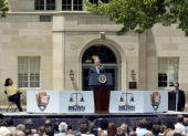 S President George W Bush speaks to a crowd in front of the Monroe Elementary School as Cheryl Brown Henderson one of the children of the late...