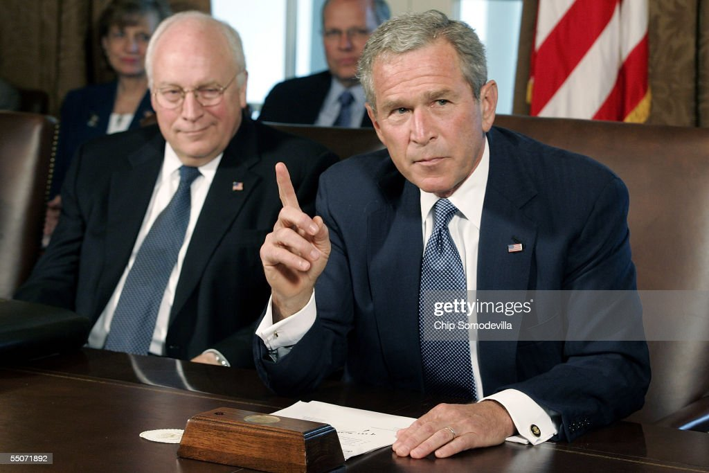 US President George W Bush speaks to his cabinet while US Vice President Dick Cheney listens at the White House September 6 2005 in Washington DC...