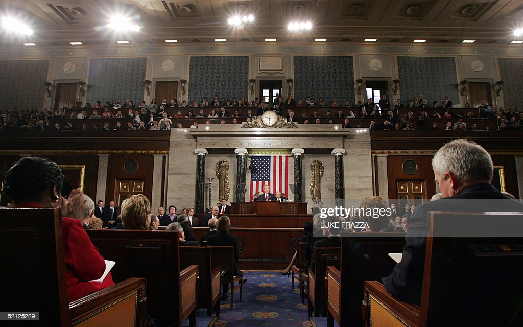 President George W Bush speaks to members of Congress on the floor of the House of Representatives during his fourth State of the Union address 02...
