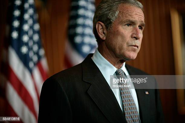 President George W Bush speaks to reporter following his visit to the Walter Reed Army Medical Center in Washington DC Bush refused to rule out an...