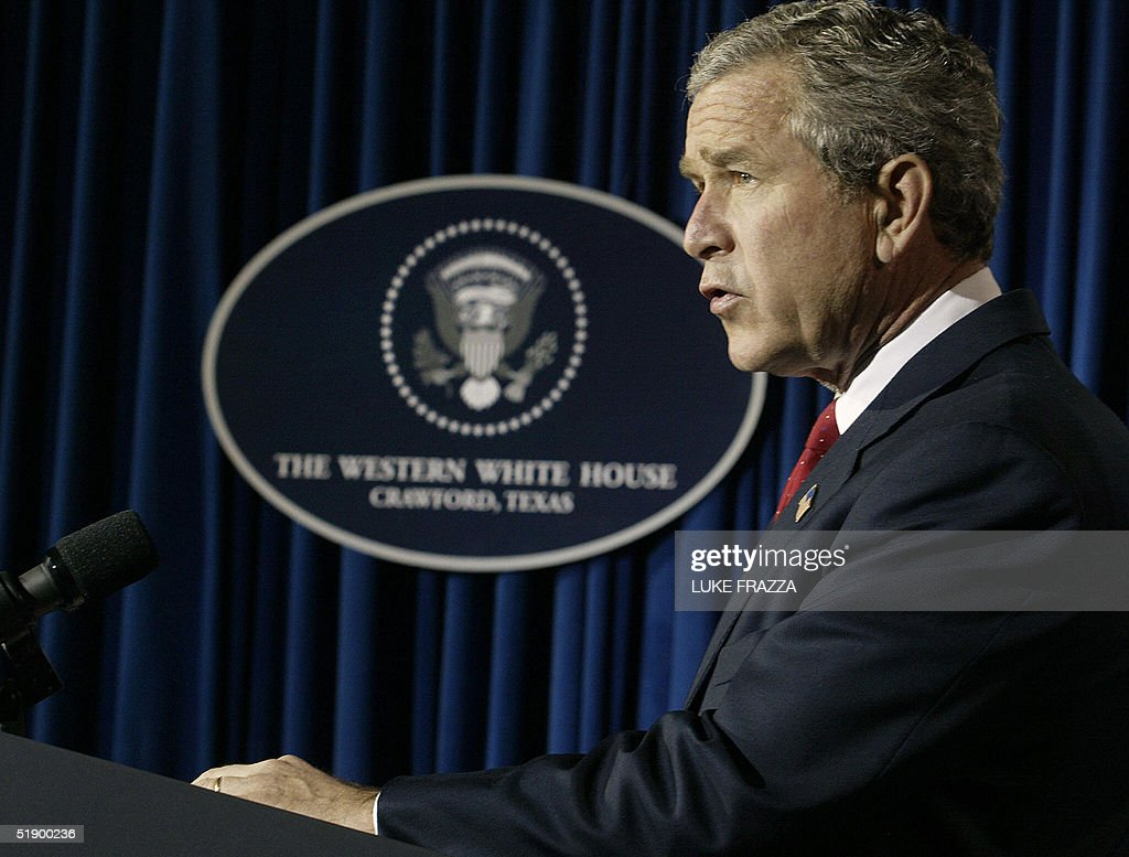 US President George W. Bush speaks to reporters 29 December 2004, near his ranch in Crawford, Texas about the US's response to the massive loss of life in Indian Ocean nations where more than 61,000 people have died after the violent crush of a 26 December 2004 tsunami. The US has pledged aid to the stricken nations. The Bushes are spending a week at the ranch before returning to Washington, DC 02 January 2005. AFP PHOTO/Luke FRAZZA