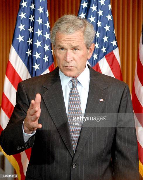 S President George W Bush speaks to reporters after visiting wounded soldiers at Walter Reed Army Medical Center July 3 2007 in Washington DC The...