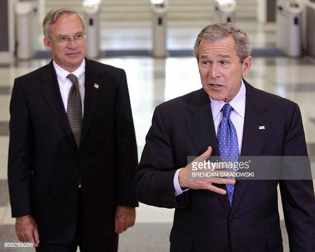US President George W Bush speaks to reporters with CIA Director Porter Goss at the headquarters of the Central Intelligence Agency 03 March 2005 in...