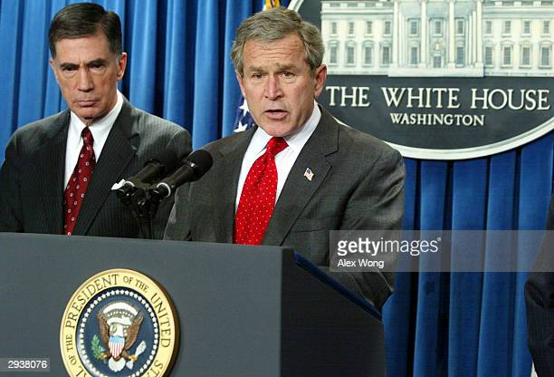 S President George W Bush speaks to the media as former Sen Chuck Robb listens February 6 2004 at the briefing room of the White House in Washington...