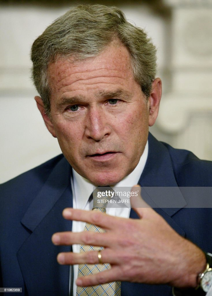 US President George W. Bush speaks to the media during a meeting with Chilean President Ricardo Lagos (not shown) in the Oval Office of the White House 19 July 2004 in Washington, DC. Bush and Lagos were to discuss democracy and trade in Latin American, notably on the free trade agreement between the two countries that took effect 01 January. Since the deal, Chile's exports to the United States have jumped by 13 percent, while US exports to Chile rose 13 percent. AFP Photo/Stephen JAFFE