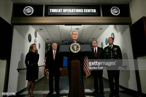 President George W Bush speaks to the press during his visit to the National Security Agency in Fort Meade Maryland Alongside Bush are Homeland...
