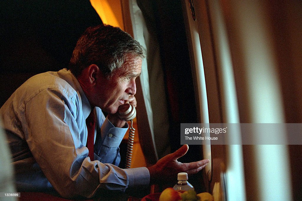 S President George W Bush speaks to Vice President Dick Cheney by phone aboard Air Force One September 11 2001 after departing Offutt Air Force Base...