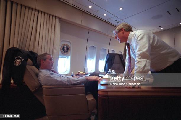 President George W Bush speaks with White House Chief of Staff Andy Card Tuesday Sept 11 aboard Air Force One Photo by Eric Draper Courtesy of the...
