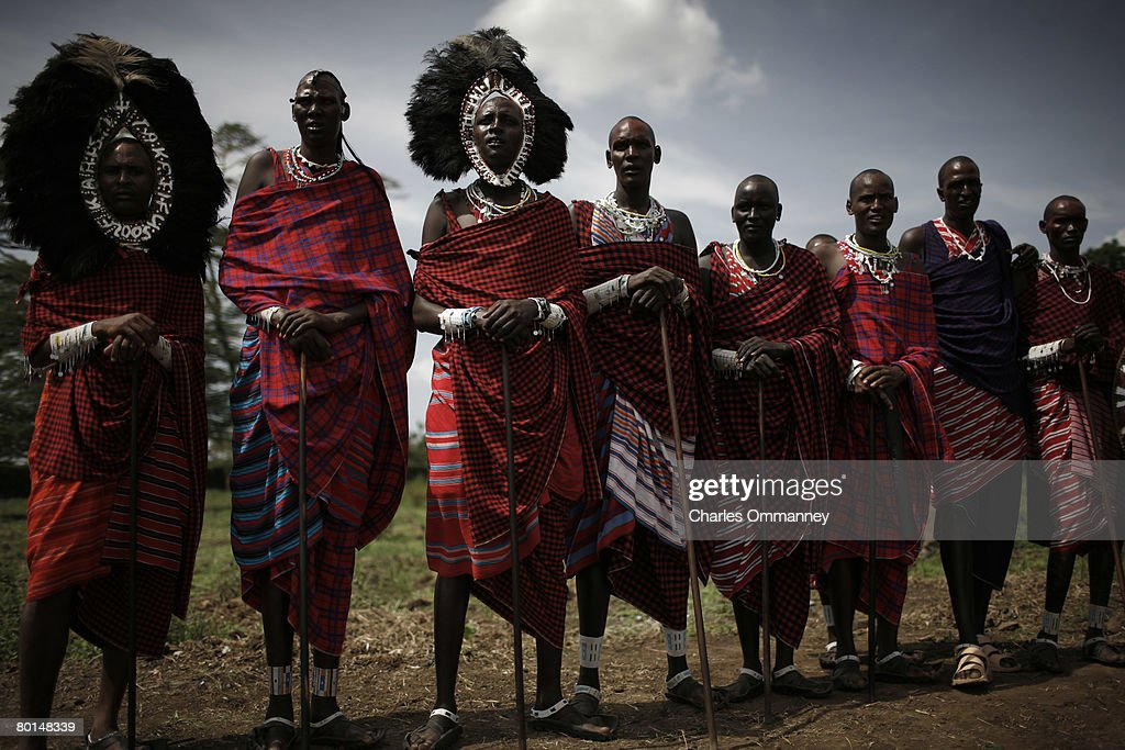 US President George W. Bush stands with traditional dancers during a tour of the Maasai Girls School on February 18, 2008 in Arusha, Tanzania. Bush unveiled a new plan Monday to hand out millions of bed-nets to defend every Tanzanian child aged one to five from the mosquitoes that spread deadly malaria.
