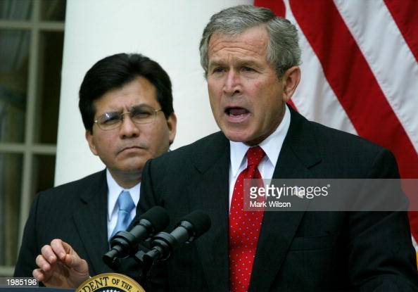 S President George W Bush stands with White House legal counsel Alberto Gonzales while speaking about judicial independence and the judicial...