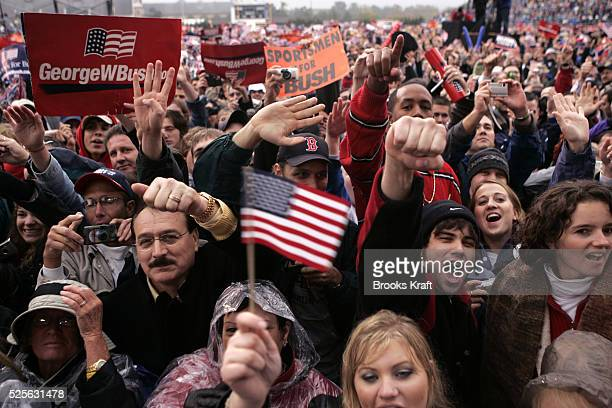 US President George W Bush supporters crowd at a campaign rally at Hersheypark Stadium in Hershey Pennsylvania October 21 2004
