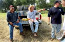 S President George W Bush takes a break from cedar clearing at his ranch August 9 2002 in CrawfordTexas Also pictured are friend Ken Englebrecht...