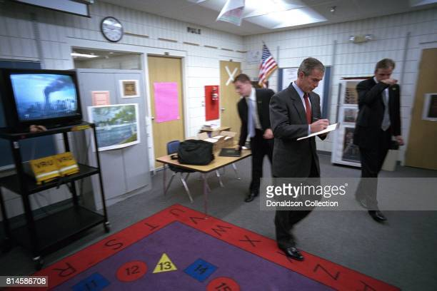 President George W Bush takes notes as he listens to news coverage of the World Trade Center terrorist attacks Tuesday Sept 11 during a visit to Emma...