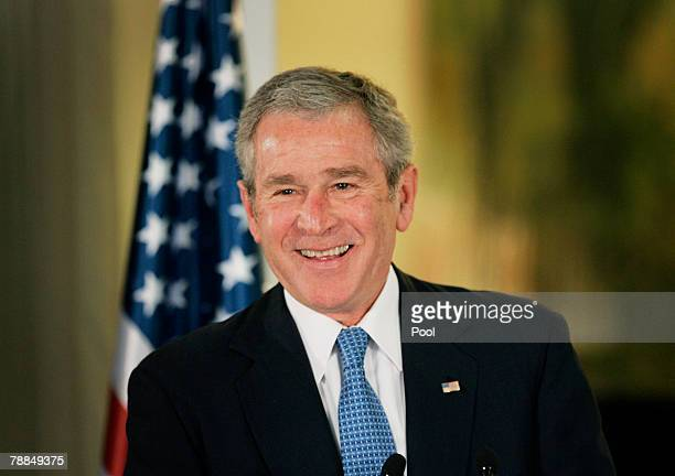 S President George W Bush takes part in a joint news conference with Israeli Prime Minister Ehud Olmert following their meeting at Olmert's residence...