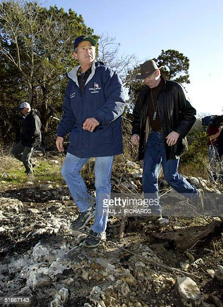 President George W Bush takes reporters on a tour of his Praire Chapel Ranch 02 January near Crawford Texas Bush accused North Korean leader Kim...