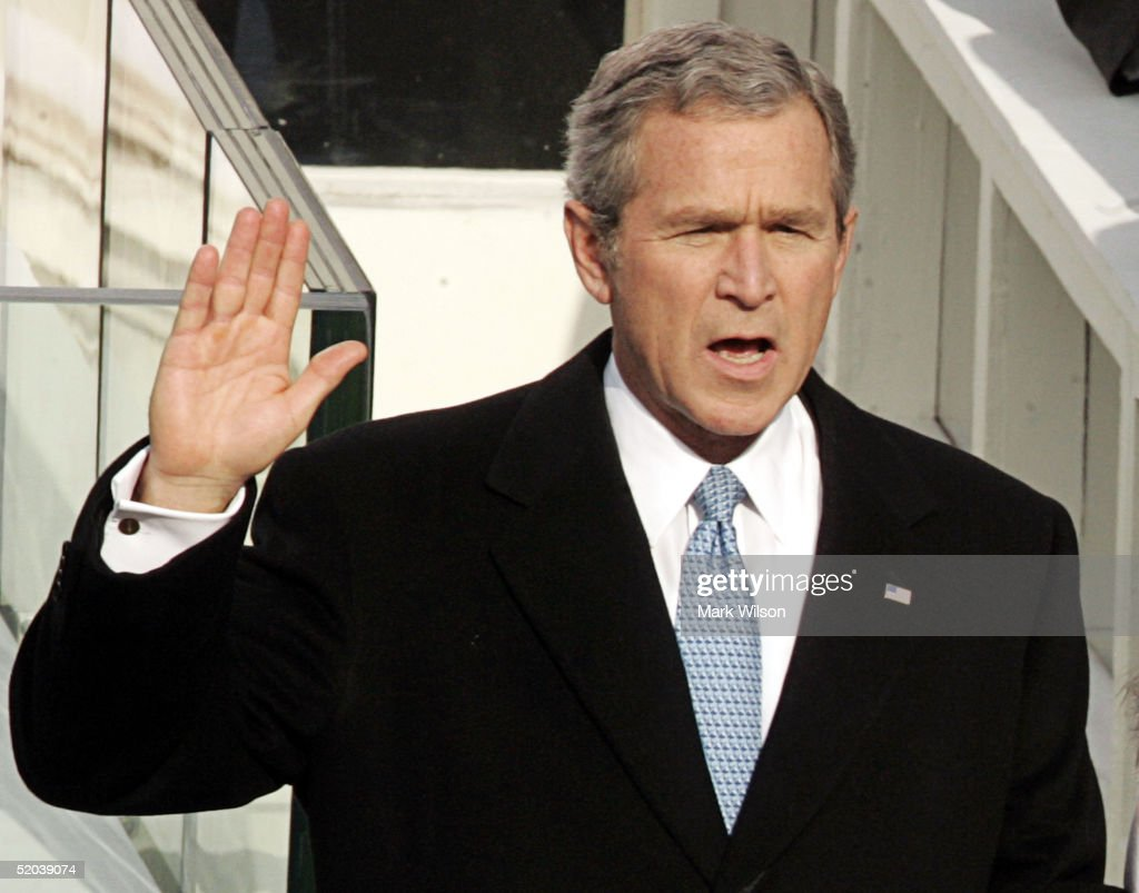 U.S. President <a gi-track='captionPersonalityLinkClicked' href=/galleries/search?phrase=George+W.+Bush&family=editorial&specificpeople=122011 ng-click='$event.stopPropagation()'>George W. Bush</a> takes the oath of office during the inaugural ceremony January 20, 2005 in Washington, D.C. Bush?s inaugural address outlined his plans to pursue freedom around the world and push an agenda at home championing freedom in the world as the surest path to peace.