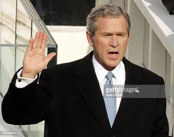 S President George W Bush takes the oath of office during the inaugural ceremony January 20 2005 in Washington DC Bushs inaugural address outlined...