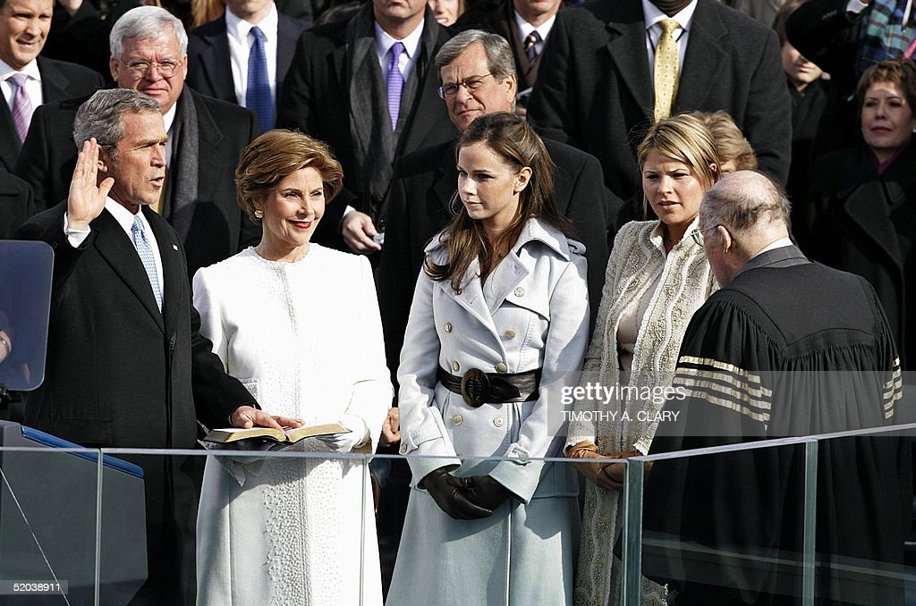 US President George W. Bush takes the oath of office for his second four-year term from Chief Justice William Rehnquist (R) before First Lady Laura (2L) and twin daughters Jenna (3L) and Barbara (4L) 20 January 2005 on Capitol Hill in Washington, DC. AFP PHOTO/Timothy A. CLARY