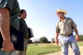 S President George W Bush talks with Deputy Chief of Staff Joe Hagin and deputy press secretary Scott McClellan on August 6 2001 at his ranch in...