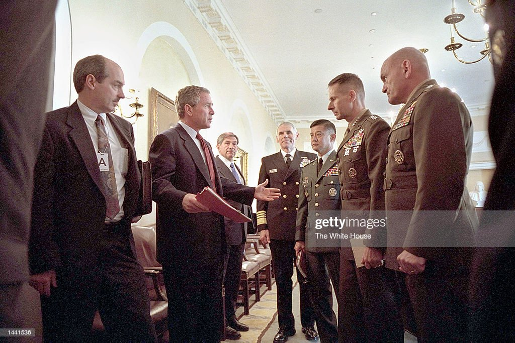 S President George W Bush talks with the Chiefs of Staff of the armed forces after a meeting in the Cabinet Room October 23 2001 at the White House...