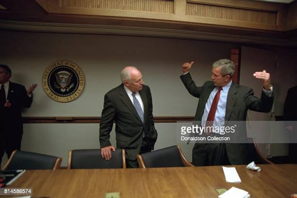President George W Bush talks with Vice President Dick Cheney in the President's Emergency Operations Center Tuesday Sept 11 after returning to the...