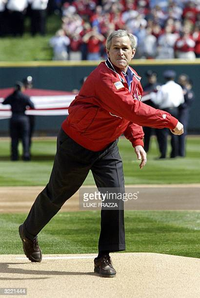 President George W Bush throws out the ceremonial 'First Pitch' at Busch Stadium prior to the ST Louis Cardinals/Milwaukee Brewers Major Leage...