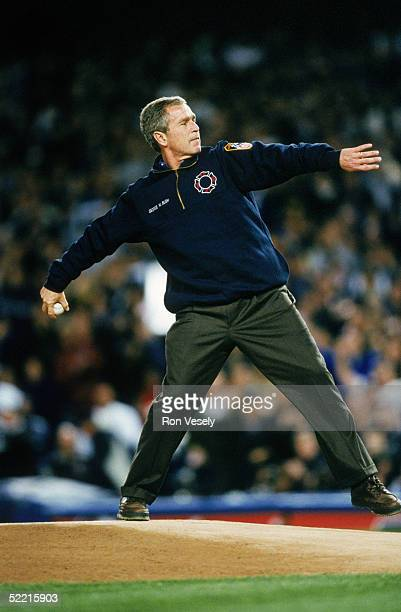 President George W Bush throws the ceremonial first pitch prior to Game Three of the 2001 World Series between the Arizona Diamondbacks and the New...