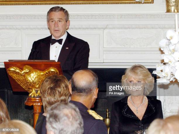 US President George W Bush toasts his guests The Prince of Wales and Duchess of Cornwall during a black tie dinner at the White House in Washington...