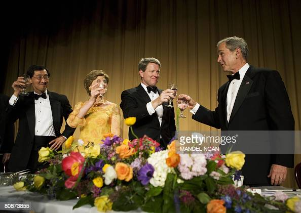 US President George W Bush toasts White House Correspondents Association board member Edwin Chen of Bloomberg News First Lady Laura Bush and ABC News...