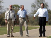 President George W Bush walks his Prarie Chapel Ranch with Canadian Prime Minister Paul Martin and Mexican President Vicente Fox 23 March 2005 near...