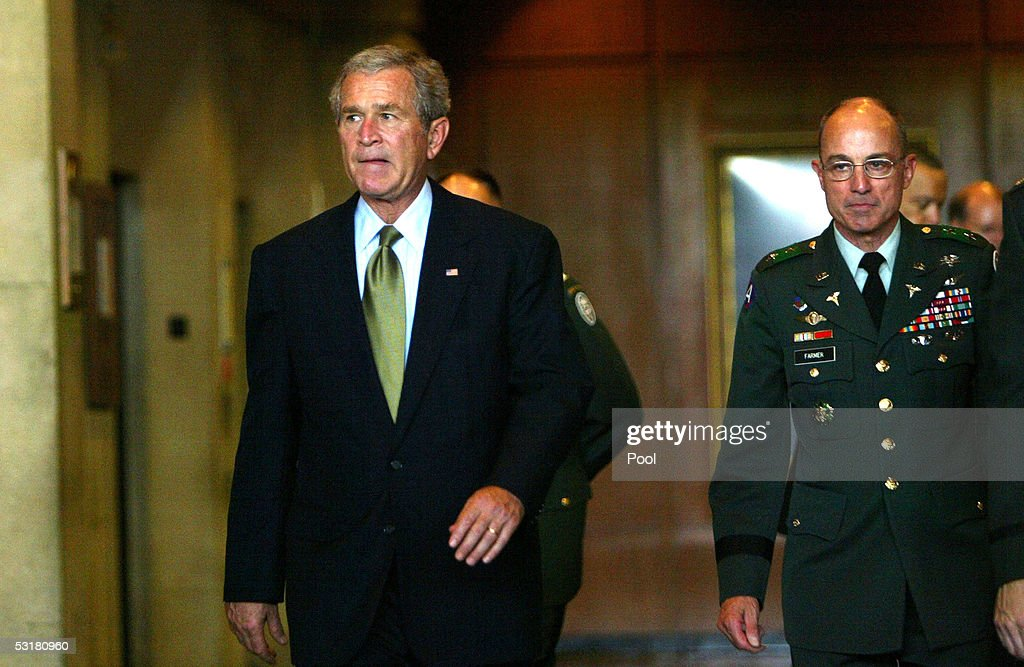 US President George W. Bush walks towards the door of Walter Reed Army Medical Center after visiting soldiers injured during Operation Iraqi Freedom July 1, 2005 in Washington, DC. On Bush's right is Major General Ken Farmer.
