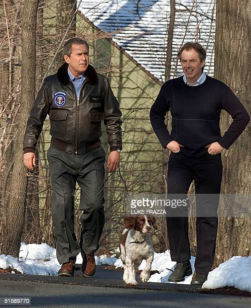 President George W Bush walks with British Prime Minister Tony Blair and Bush's dog Spot 23 February 2001 at the Camp David presidential retreat in...