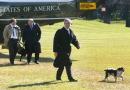 S President George W Bush walks with his dog Spot followed by Press Secretary Ari Fleischer and Deputy Cheif of Staff Joe Hagin after getting off...