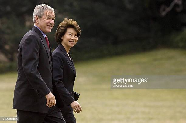 US President George W Bush walks with Labor Secretary Elaine L Chao on the South Lawn of the White House in Washington DC 29 January 2008 after...
