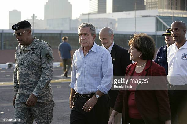 US President George W Bush walks with Lt Gen Russ Honore Homeland Security Secretary Michael Chertoff Louisiana Governor Kathline Blanco and New...
