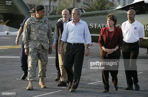 US President George W Bush walks with Lt Gen Russ Honore US Coast Guard Vice Admiral Thad Allen Homeland Security Secretary Michael Chertoff...