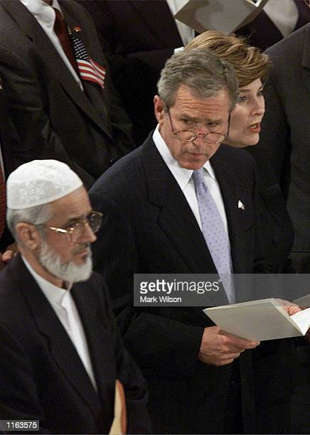 President George W Bush watches as Muzammil Siddiqi Imam of the Islamic Society of North America passes by during a memorial service for victims of...