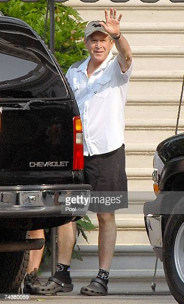 S President George W Bush waves as he departs the White House June 2 2007 in Washington DC Bush was departing to go biking