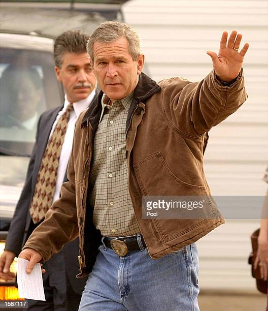 S President George W Bush waves as he leaves a polling station at the Crawford Fire Department after casting his ballot before heading back to...