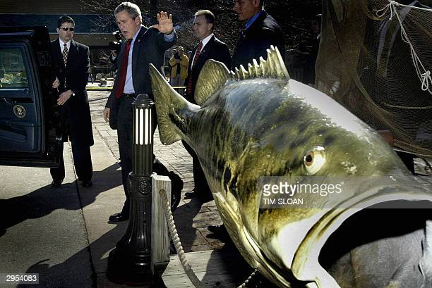 President George W Bush waves as he talks to the press about his unschedueled visit to the Bass Pro Shops Outdoor World flagship store where he...