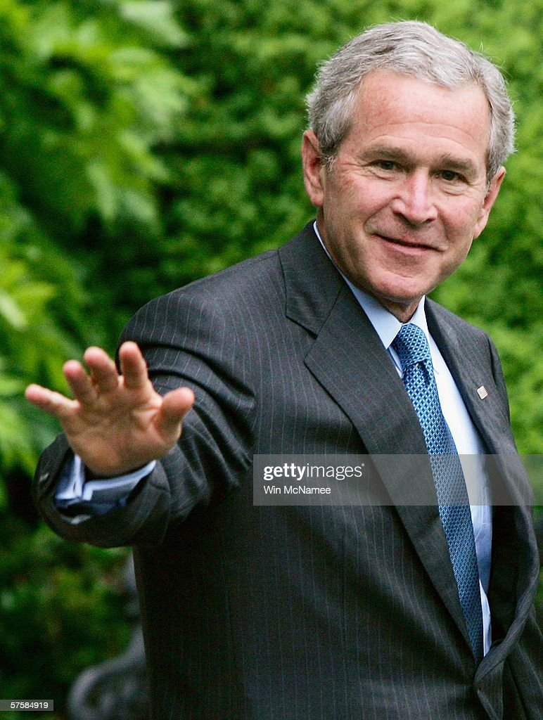 U.S. President <a gi-track='captionPersonalityLinkClicked' href=/galleries/search?phrase=George+W.+Bush&family=editorial&specificpeople=122011 ng-click='$event.stopPropagation()'>George W. Bush</a> waves as he walks from the White House to a waiting Marine One helicopter, after making a statement on recent reports about the National Security Agency, May 11, 2006 in Washington, DC. President Bush is traveling to Mississippi.