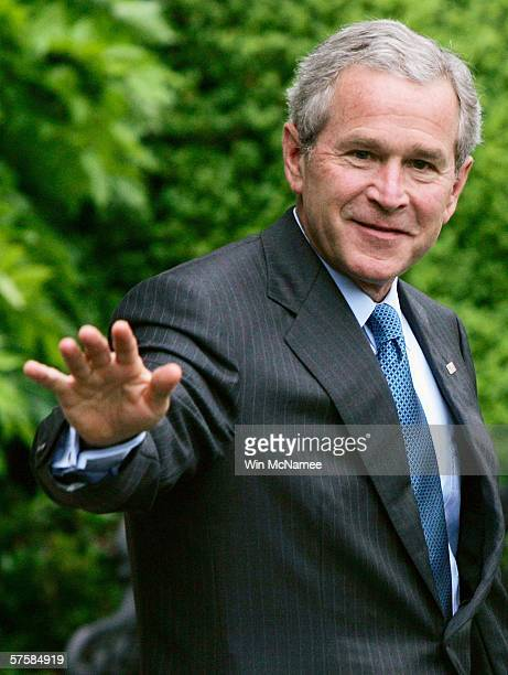 S President George W Bush waves as he walks from the White House to a waiting Marine One helicopter after making a statement on recent reports about...