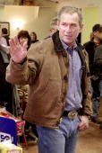 President George W Bush waves to reporters 31 December 2001 before having lunch at The Coffee Station in Crawford Texas The President said he plans...
