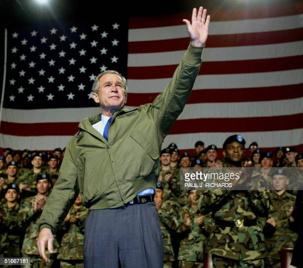 President George W Bush waves to some of the 42000 US Army soldiers based at Fort Hood TX that came to attend his speech 03 January 2003 Bush and his...