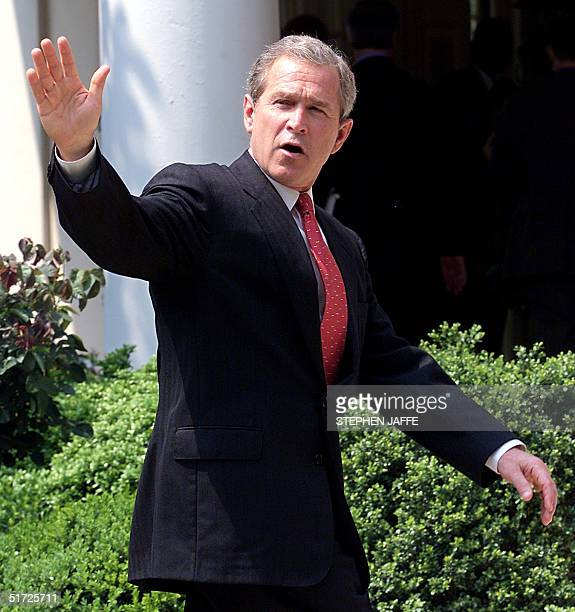 President George W Bush waves to the media after making remarks on the Global Climate change working Group's status report in preparation for the...