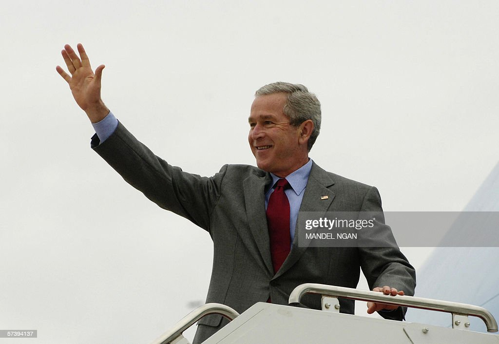 US President <a gi-track='captionPersonalityLinkClicked' href=/galleries/search?phrase=George+W.+Bush&family=editorial&specificpeople=122011 ng-click='$event.stopPropagation()'>George W. Bush</a> waves while boarding Air Force One, 21 April 2006 at Andrews Air Force Base in Maryland. Bush is heading to the state of California for a three-day visit. AFP PHOTO/Mandel NGAN