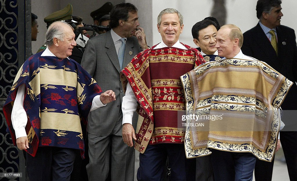 President George W Bush wearing a traditional Chilean poncho walks with Chilean President Ricardo Lagos and Russian President Vladimir Putin to the...