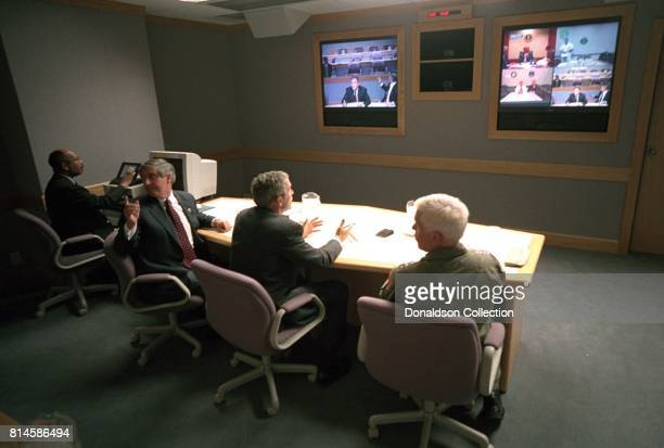President George W Bush White House Chief of Staff Andy Card left and Adm Richard Mies conduct a video teleconference Tuesday Sept 11 at Offutt Air...