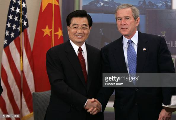 US President George W Bush with Chinese President Hu Jintao at their bilateral meeting in Santiago November 20 2004 during the annual Asia Pacific...